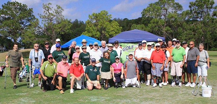 amputee golfers group photo on golf course