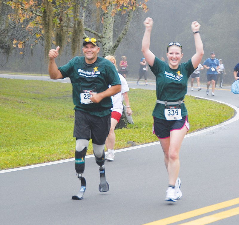 amputee and prosthetist racing together