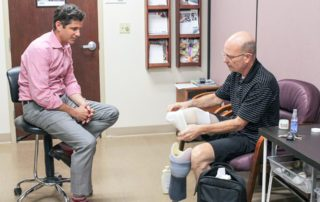 Leg amputee putting on Prosthetic leg