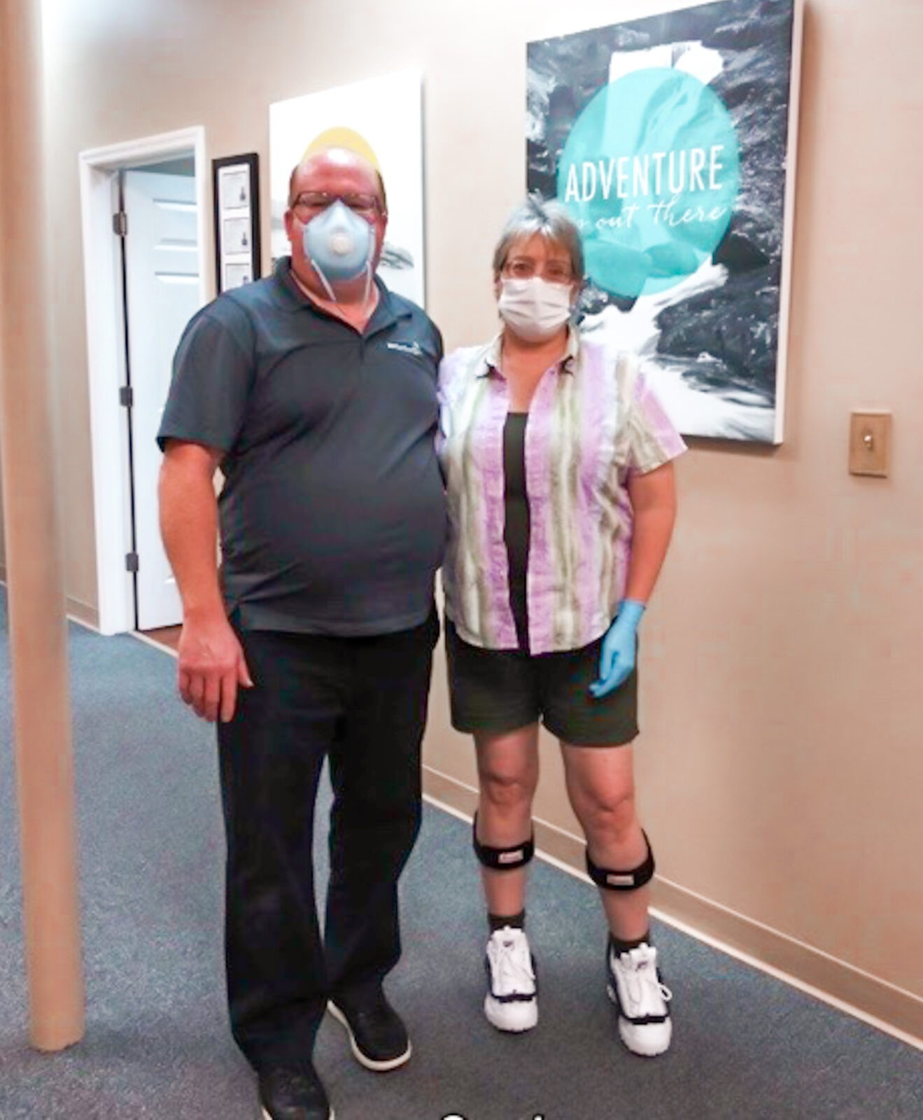 Woman wearing bilateral TurboMed AFOs standing with her male orthotist.