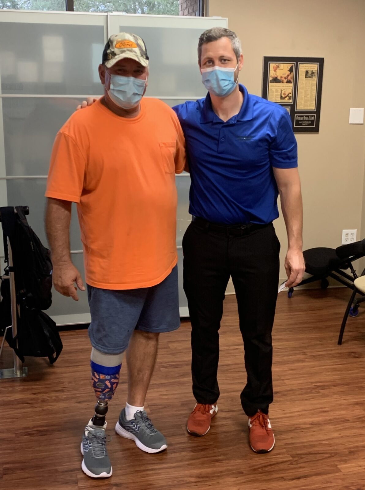 Below knee amputee with prosthetist prosthetic practitioner
